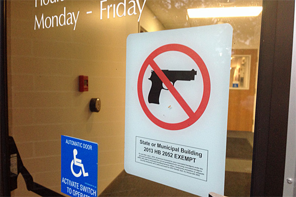 "New signs on doors to the Prairie Village Municipal Building note the city's exemption from HB 2052, which requires city's to allow firearms in city buildings unless the buildings have ""adequate security measures."""
