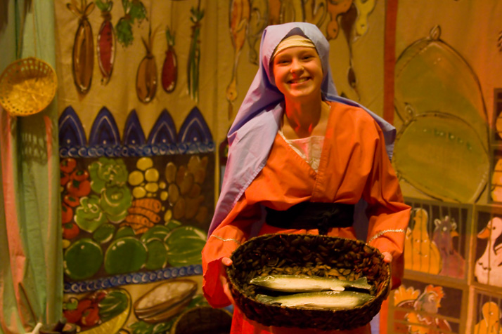 A vendor offers fish in the Jerusalem market in one of the early scenes from the production.