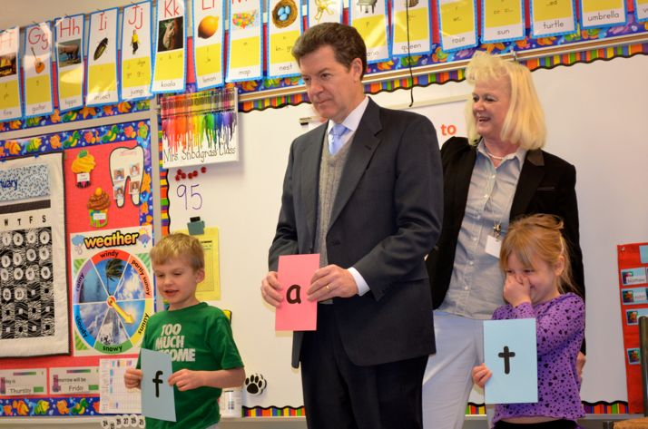 Kansas Governor Sam Brownback participated in a reading exercise with kindergarten students in Terry Snodgrass's class at Roesland Elementary as part of his tour to promote the idea of all-day kindergarten in the state.