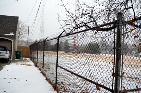 In other spots the fence is very close to residential property.