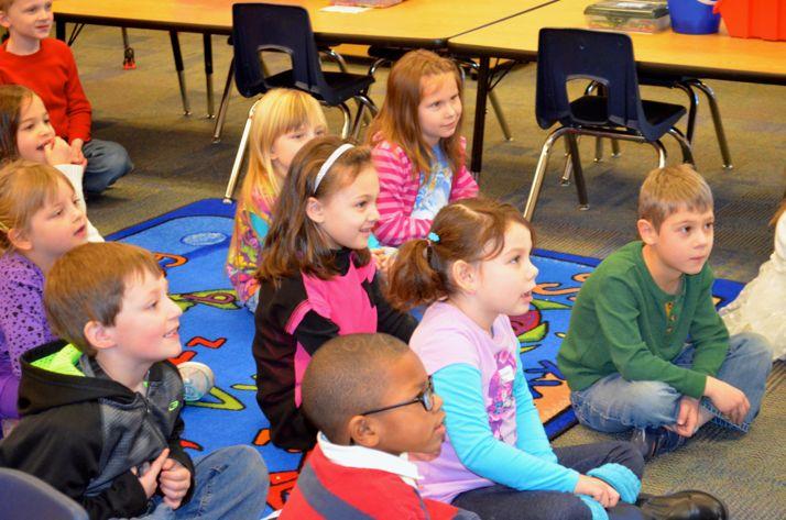 Roesland kindergarten students watched Gov. Sam Brownback participate in a reading exercise.
