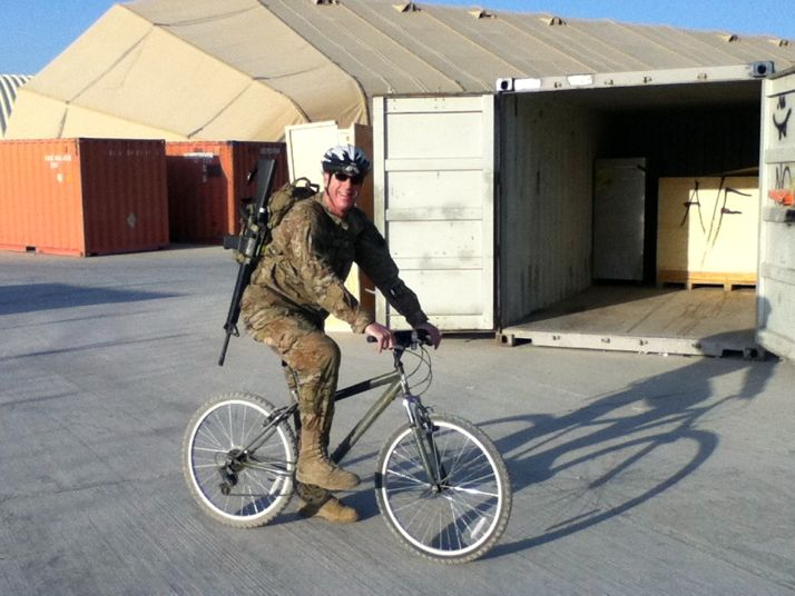 Kotcher riding Bagram Airfield on the bike he bought after he arrived.