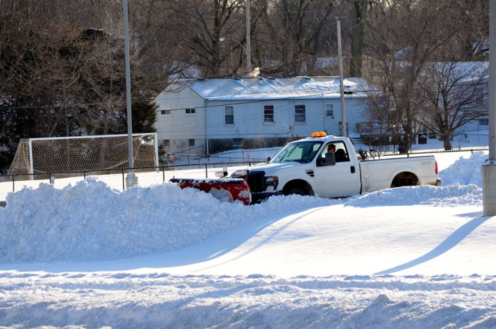 Lots were still being cleared at schools late Wednesday. Here the Highlands Elementary lot was being plowed in the late afternoon.