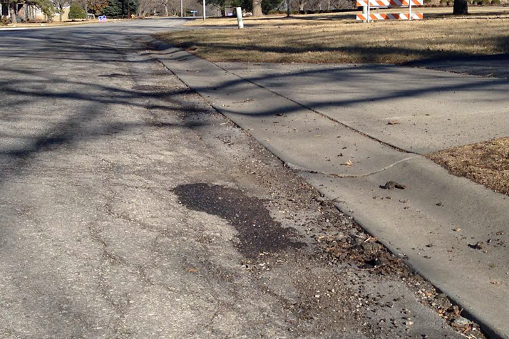 Deteriorating asphalt on 89th Street in Prairie Village. The city faces considerable costs to do recommended repairs and maintenance in the coming years.