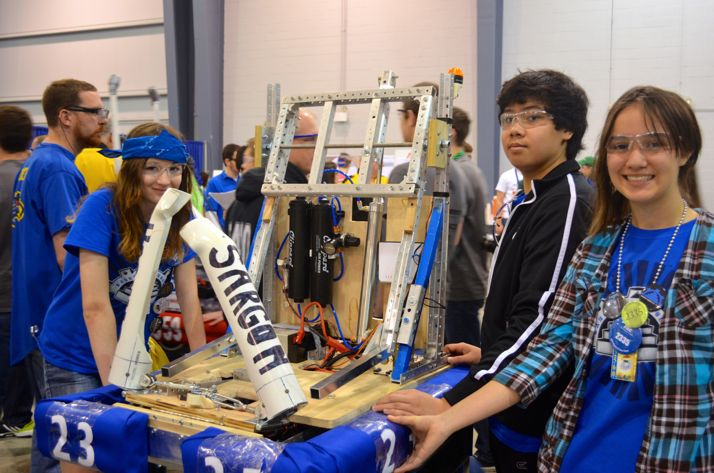 Some of the SM East team members taking their robot to the pits after a round.