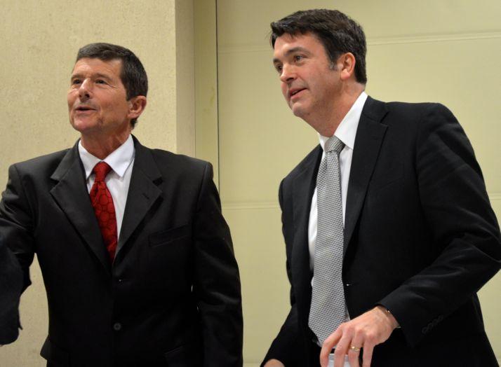 Steve Schowengerdt and Dave Shepard receive congratulations after the candidate debate Thursday.