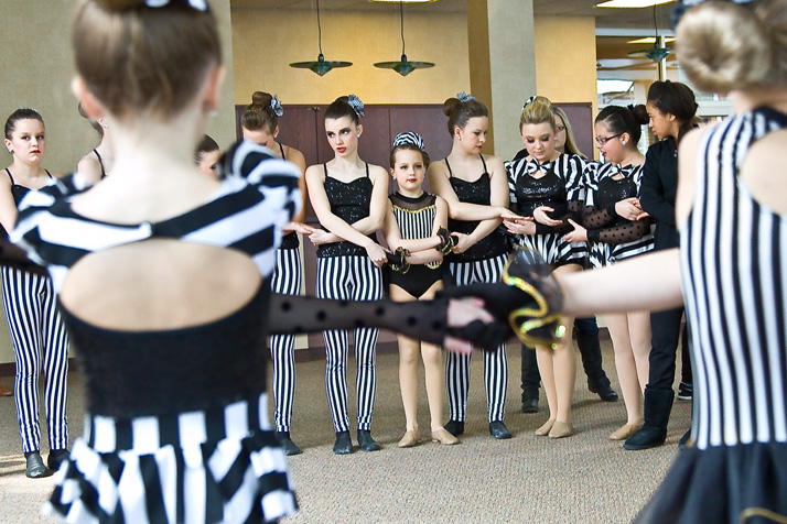 Members of The Pointe's competition team gathered before the performance of their production act Saturday.