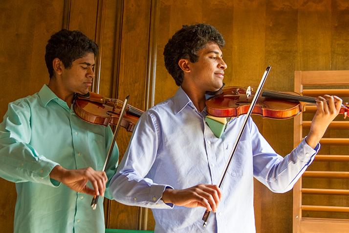Bhavish (left) and Akshay Dinakar practice at their Prairie Village home.