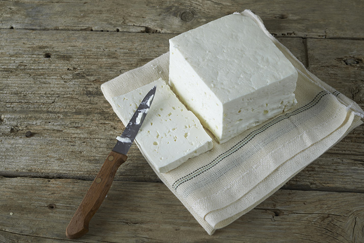 Whipping feta makes is a perfect topping for grilled bread.