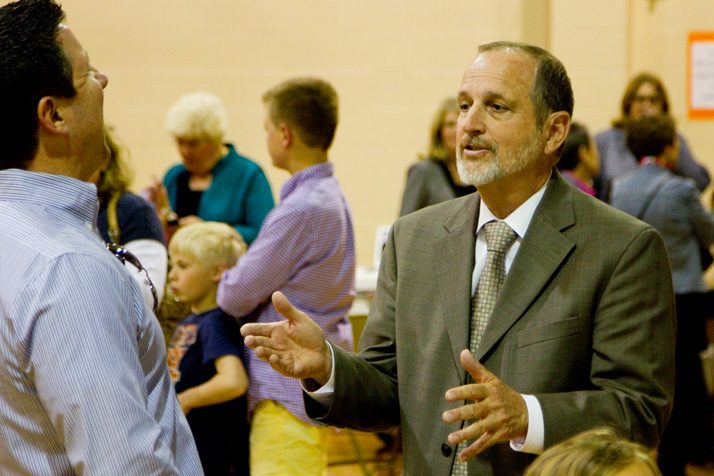 Ken Emley chatted with parents Thursday at a reception honoring him as he retires as Corinth principal.