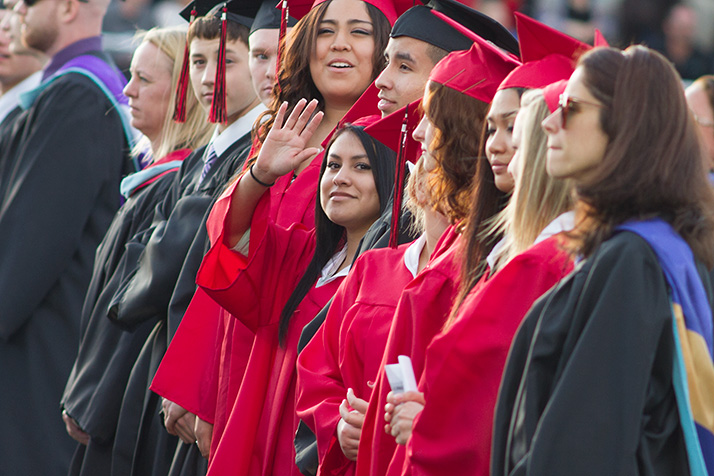 Graduates waved to their families as they entered the stadium for SM North's ceremony Tuesday.