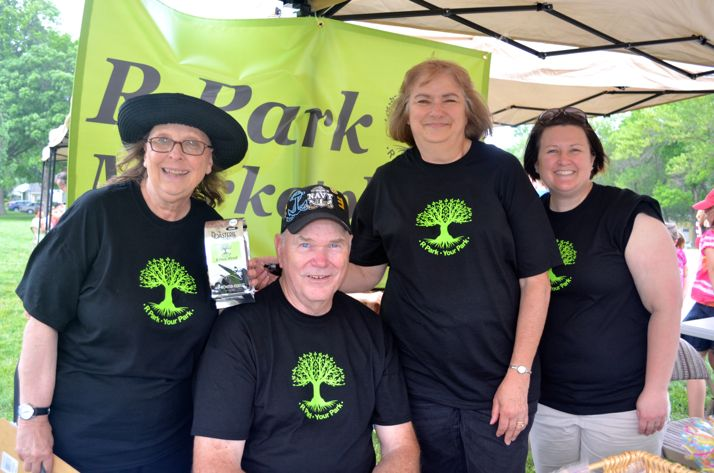 Volunteers raising money to improve R Park include Gretchen Davis (L-R), Tom Hyde, Judy Hyde and Sara Coe. They were manning the booth at the block party Saturday.