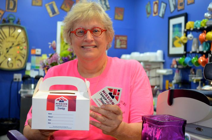 Twisted Sisters Coffee Shop proprietor Sandi Russell shows one of the drawing boxes that can be found at participating buisnesses.