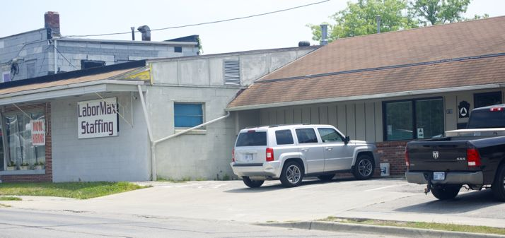 Two tenants in the building across the street from Taco Republic have complained about parking.