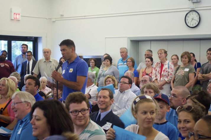 Michael Poppa addressed the standing room crowd at the Roeland Park Community Center.