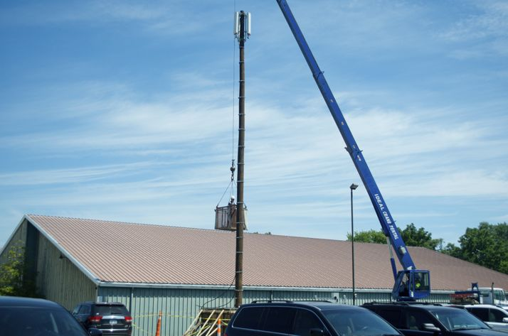 Work on moving cell tower locations began this week - the first step in the Woodside Village construction.