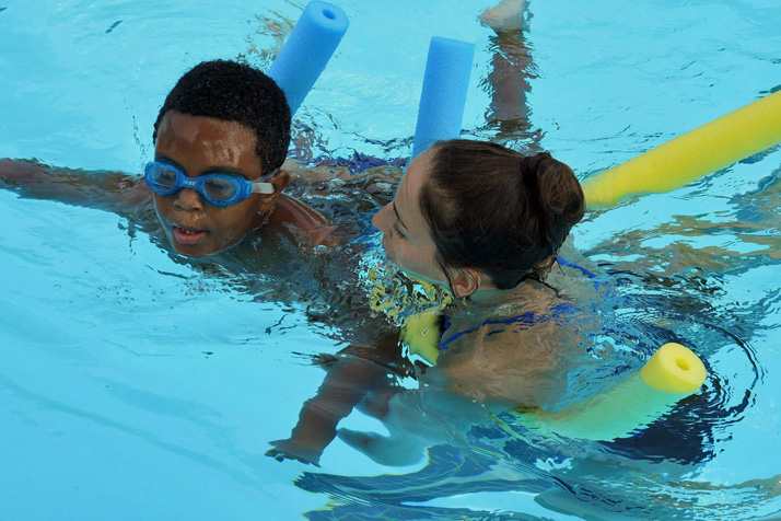 Instructor Natalie Blair works with student Malcom Gist at the Fairway Pool. Photo courtesy Greg Peters, University of Kansas Medical Center.
