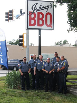 Mission police waited tables at Johnny's BBQ to raise funds for the Special Olympics.