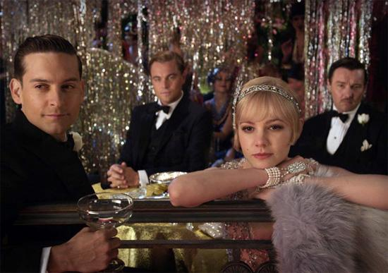 In the Great Gatsby, what are the worlds Gatsby escapes from?