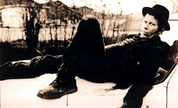 Tom_waits__sitting_on_hood_bw_1217248150_crop_178x108