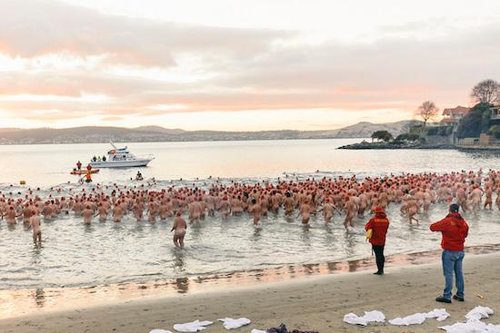 Dozens of naked people run into a cold sea