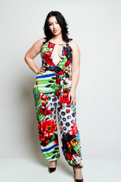 HALTER STYLE TIES AT WAIST SLITS DOWN THE SIDES FLORAL PRINT JUMPSUIT