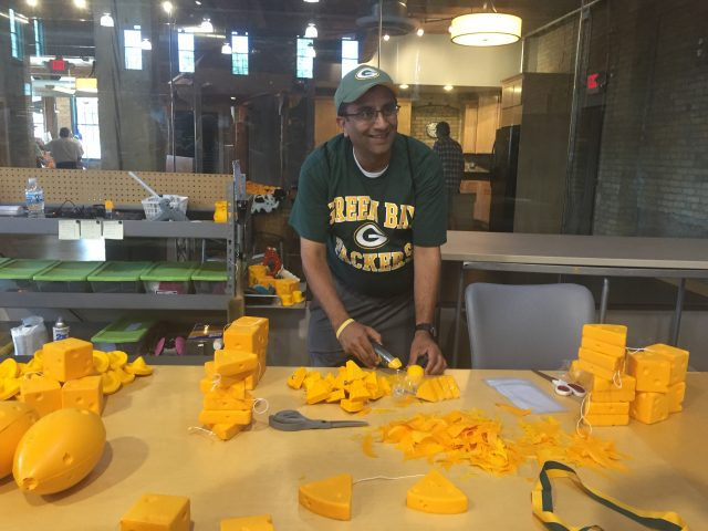 """Say cheese! Packers fan poses by """"fresh cheese"""" at Foamation during Doors Open."""