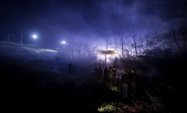 A group enters the graveyard at The Hill Has Eyes Haunted House in Franklin.