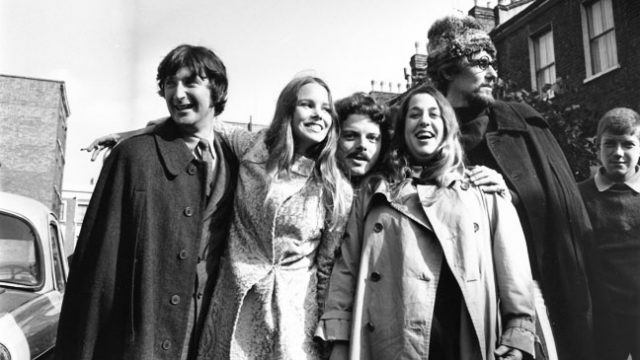 6th October 1967: California based pop-folk vocal harmony group Mamas And The Papas in England, celebrating after theft charges were dropped against 'Mama' Cass Elliot who was accused of stealing blankets and keys from the Royal Garden Hotel in Kensington on an earlier visit. From left to right, Denny Doherty, Michelle Gilliam (Michelle Philips), unknown, 'Mama' Cass Elliot (1943 - 1974) and John Phillips (1935 - 2001). (Photo by Les Lee/Express/Getty Images)