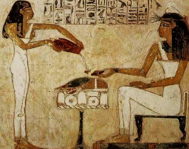 Egyptian hieroglyphics depict the pouring of beer.