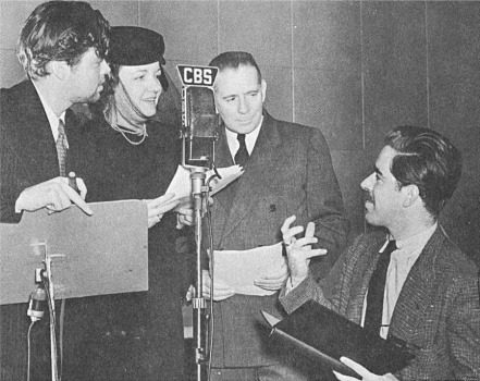 "Director William N. Robson confers with Orson Welles and oher performers during rehearsals for a late 1930s broadcast of ""The Columbia Workshop"""