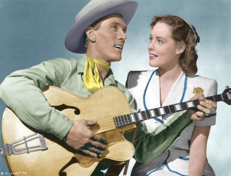 "Ken Curtis in his singing cowboy days, pictured here with co-star Adelle Roberts in the 1946 Columbia Pictures release ""Throw a Saddle on a Star""."