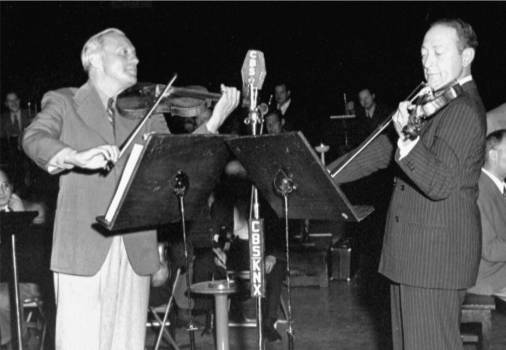 Jack Benny and Jascha Heifetz perform a memorable violin duet
