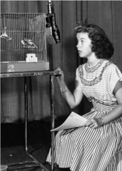 "Hostess Shirley Temple hopes birds will sing in the air to fill a solider's ""command"""