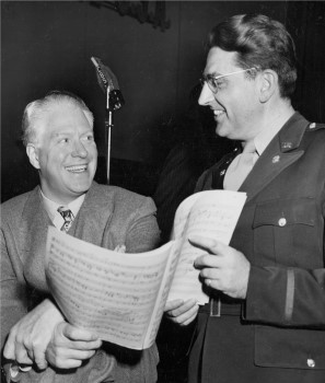 "During World War II, Willson served as musical director of the Armed Forces Radio Service. He is pictured here with Nelson Eddy during reharsals for a ""Command Performance"" program in 1945."