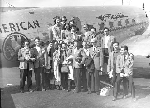 Sonny Dunham and his Orchestra take a break from the traditional travel of bus and auto and, instead, hop a streamlined plane to make their next engagement