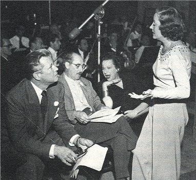 "Tallulah Bankhead chats with David Brian while Fanny Brice kvetches with Groucho Marx prior to a ""Big Show"" broadcast"