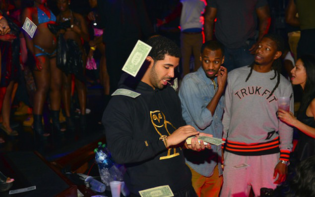 Drake throwing money