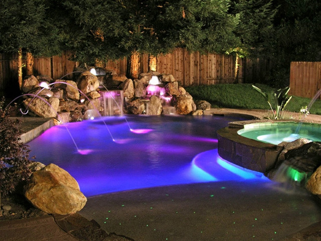 He S Out By The Pool Which Is Lit With Led Lights Causing It To Appear Flavored Neon