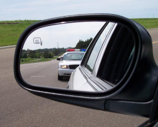 his rear-view mirror  Police Lights In Rear View Mirror