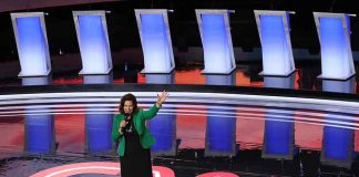 Michigan Gov. Gretchen Whitmer greets the crowd at the start of the Democratic presidential debate at the Fox Theatre in Detroit, July 30.