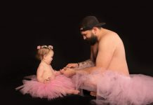 Single father and baby daughter wearing matching tutus