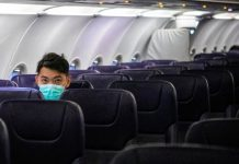 An airplane almost desolated, caused by the coronavirus worldwide outbreak