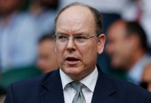 """(FILES)This file photo taken on July 10, 2019 shows Prince Albert II of Monaco attending a match at the 2019 Wimbledon Championships at The All England Lawn Tennis Club in Wimbledon, southwest London. - Monaco's Prince Albert II has tested positive for the novel coronavirus, the principality said in a statement on March 19, 2020, adding there were """"no concerns for his health"""". (Photo by Adrian DENNIS / AFP) / RESTRICTED TO EDITORIAL USE (Photo by ADRIAN DENNIS/AFP via Getty Images)"""