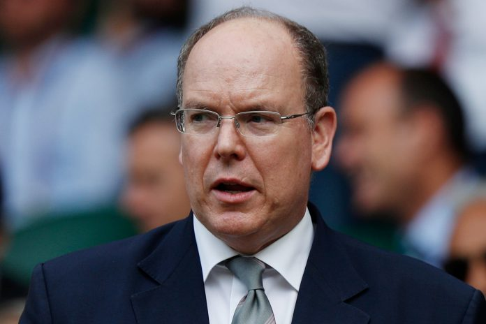 (FILES)This file photo taken on July 10, 2019 shows Prince Albert II of Monaco attending a match at the 2019 Wimbledon Championships at The All England Lawn Tennis Club in Wimbledon, southwest London. - Monaco's Prince Albert II has tested positive for the novel coronavirus, the principality said in a statement on March 19, 2020, adding there were