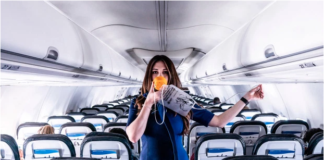 A flight attendant on an empty plane still doing the safety demonstrationCredit: Instagram/Molly Choma