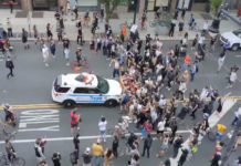 An NYPD car rams into a crowd of protesters.Twitter