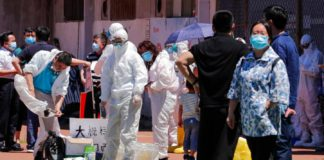"""Beijing heads to a """"strict"""" lockdown again over fears for a second wave since a new outbreak emerged in Xinfadi market area. The coronavirus was found in a chopping board used by a seller of imported salmon"""