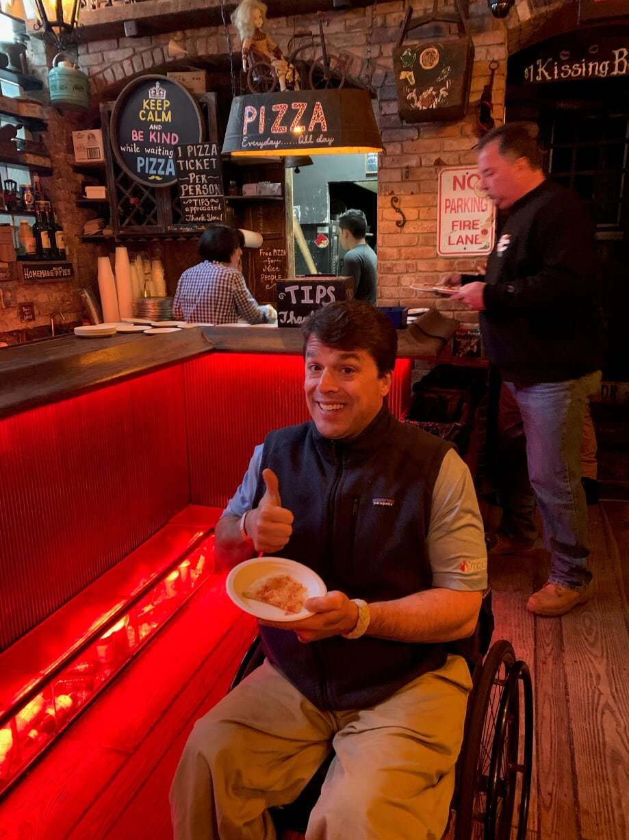 Scott Chesney gives a thumbs up as he enjoys a slice of a Johnny Mac bar pie.