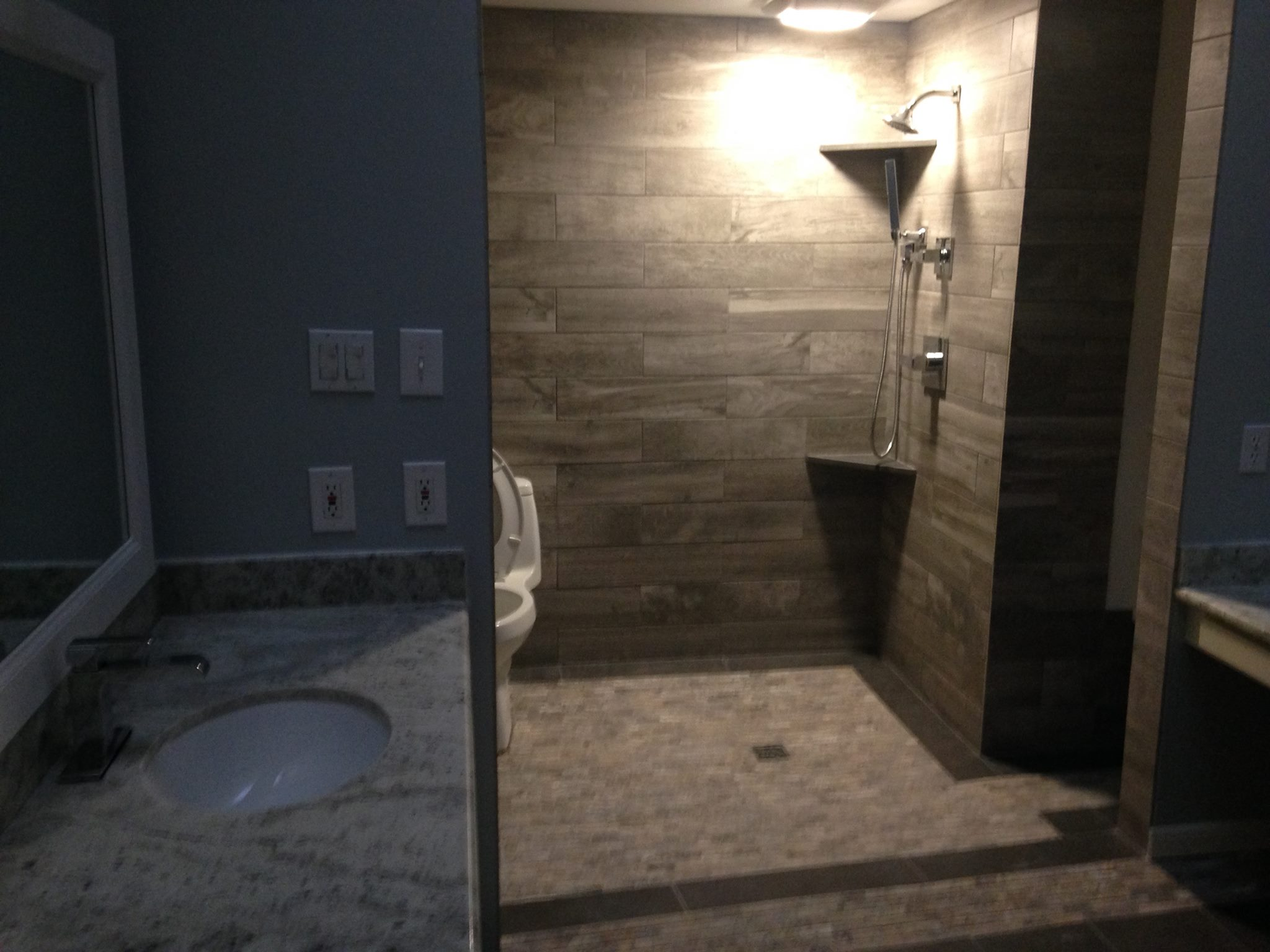 Sugarland Remodeled Shower Space With Downward Slope